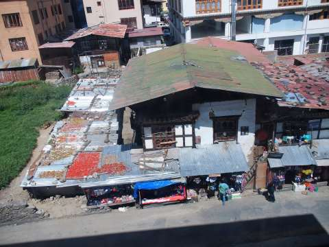 Thimphu Above the markets overlooking chillies drying